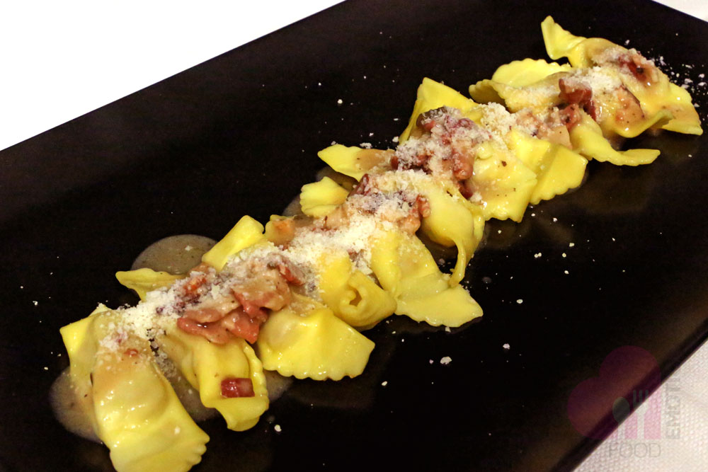 Casoncelli alla bergamasca (Ravioli typical of Bergamo filled with meat and seasoned with bacon, sage and melted butter)