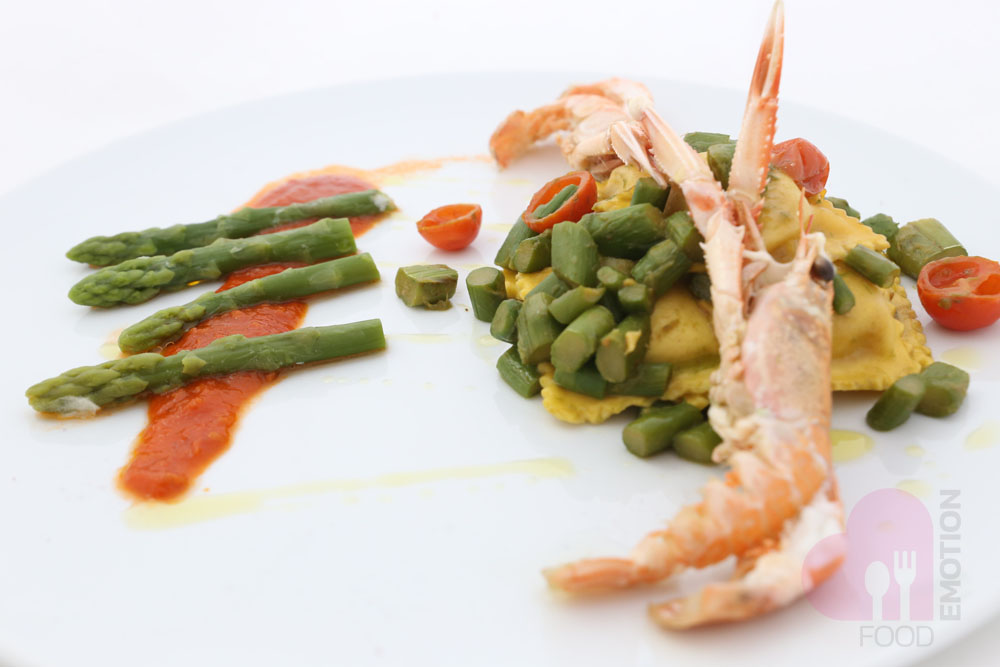 Tortelli (Italian Ravioli) with scampi and cherry tomatoes and asparagus sauce