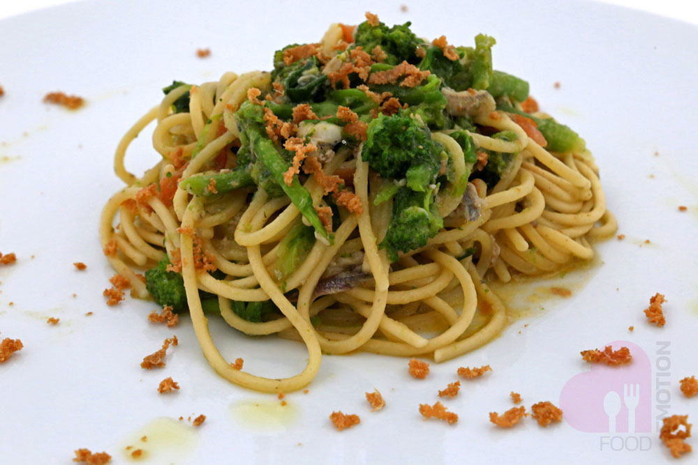 Spaghetti with turnip greens, anchovies sauce and tuna Bottarga (roe of tuna salted and pressed)