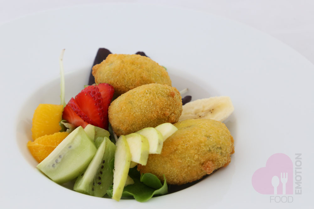 Fried ricotta in herbs with seasonal fruits in a lemon sauce