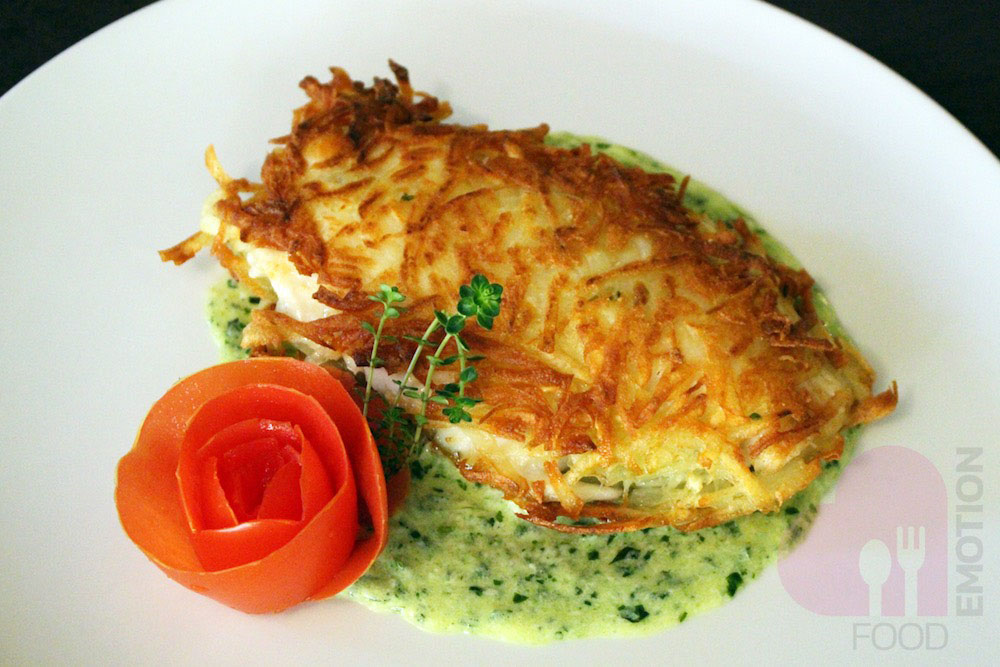 Bream crusted with potatoes on basil cream