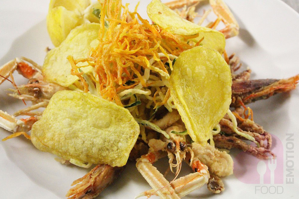 Mixed fried seafood by Garlini restaurant with crunchy vegetables