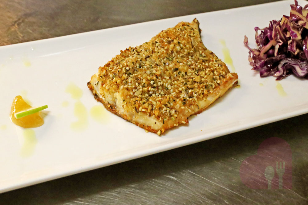 Arctic char crusted with sesame seeds, with red cauliflower salad and apple cider vinegar