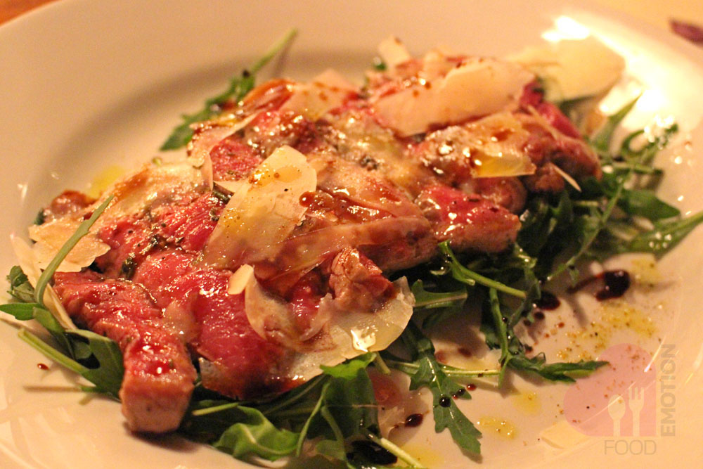 Sliced beef fillet with parmesan cheese, arugula and balsamic vinegar