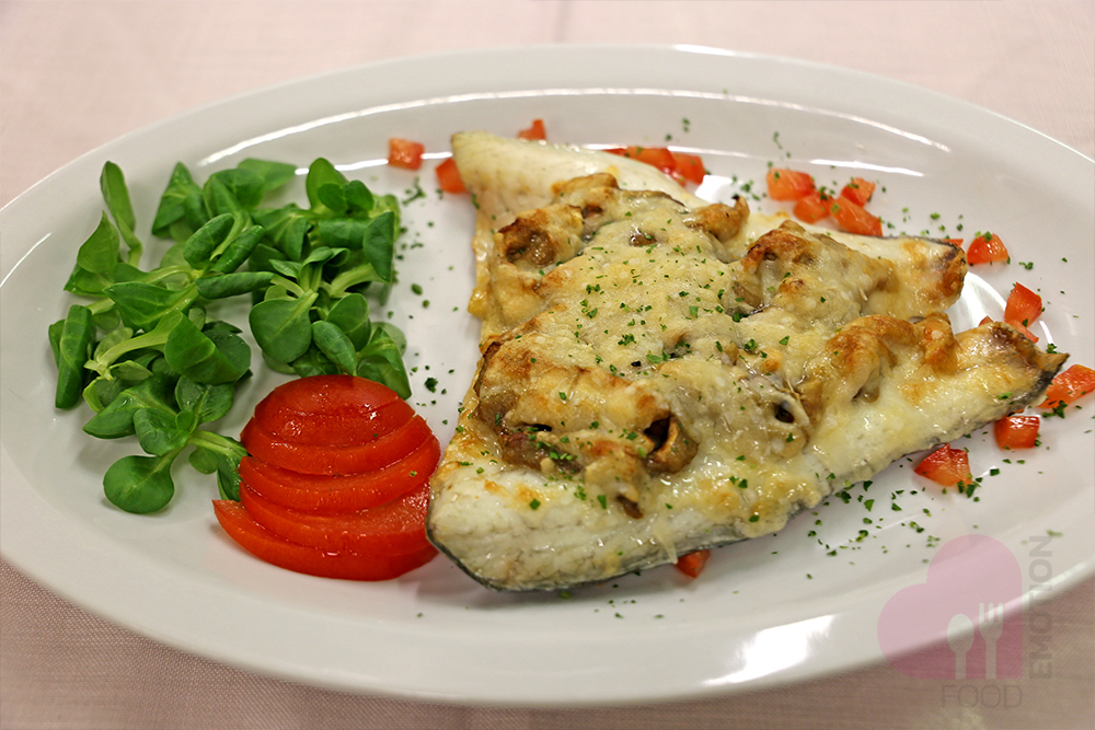 Baked sea bream with Parmesan cheese and mushrooms