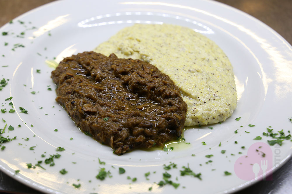 Red wine flavored braised beef with polenta
