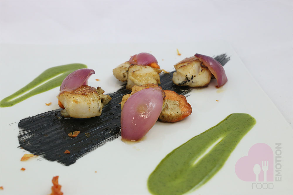 Seared scallops with red onion, basil sauce and squid ink mayonnaise