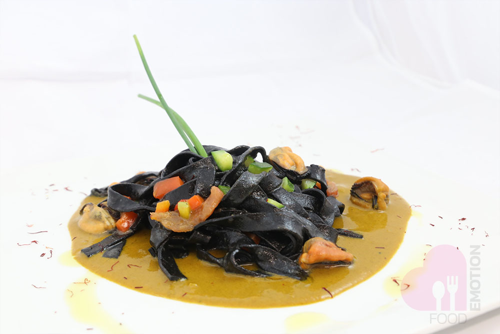 Squid ink Tagliatelle with cream of mussels and saffron soup