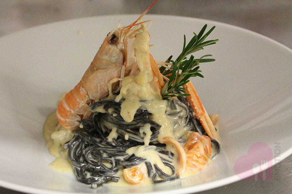 Squid ink Tagliolini (fresh pasta) with shrimp tails and creamy sweet Gorgonzola cheese