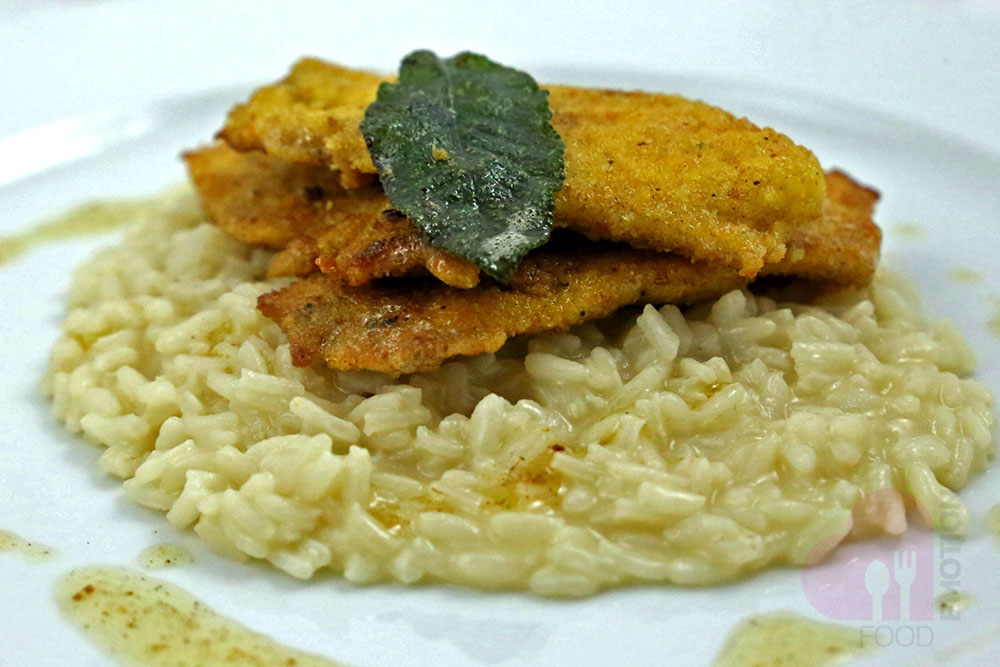 Traditional risotto with perch fillets seasoned with melted butter and sage