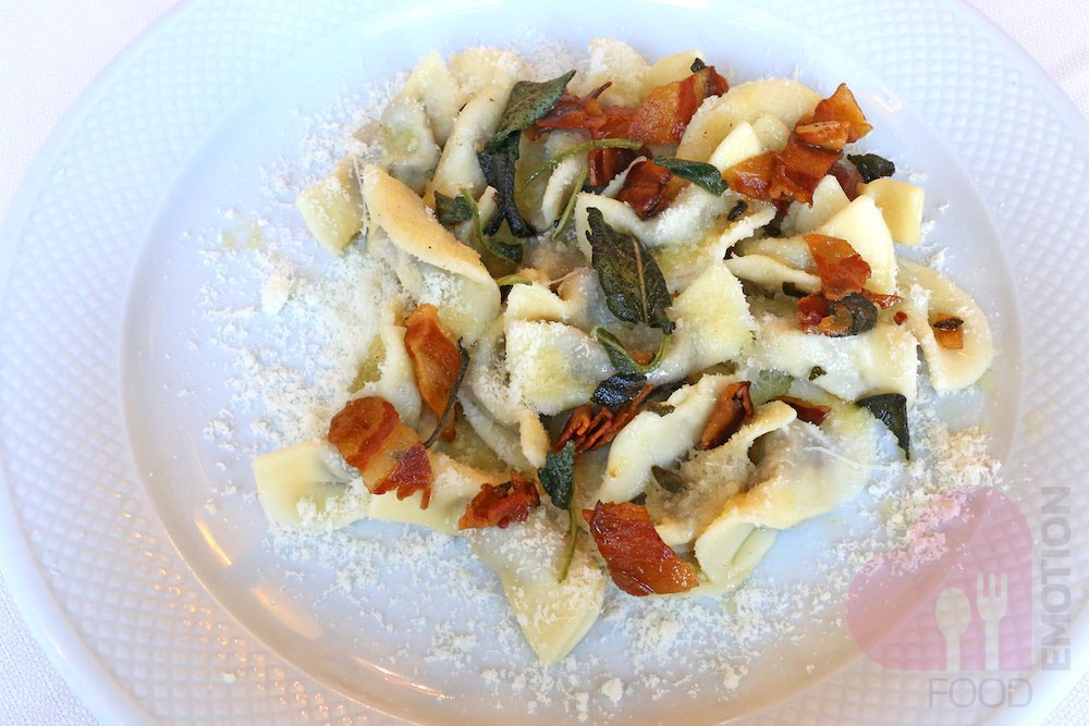 Casoncelli by Grandma Ida: ravioli filled with meat and made by following the traditional family recipe, with melted butter, bacon and sage