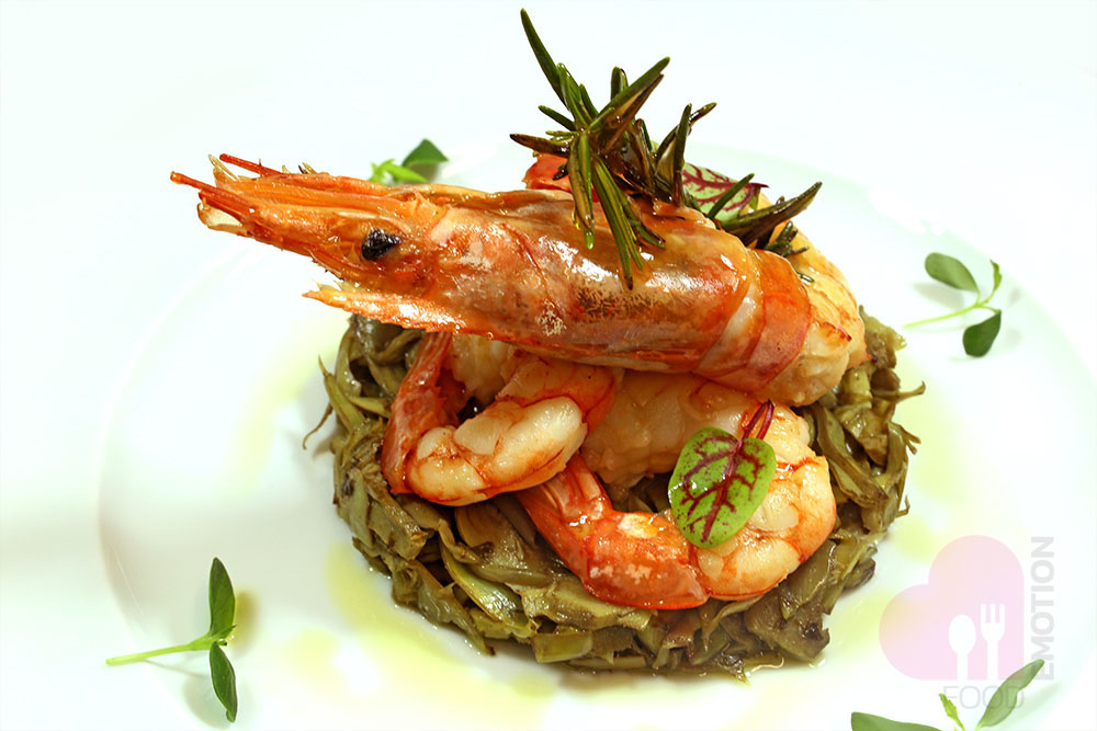 Pan-seared Drambuie flavored king prawns with artichokes cooked with oil, garlic and parsley