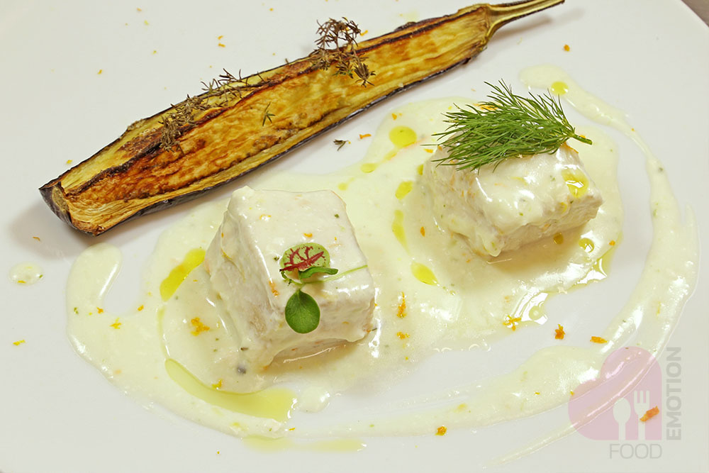 Swordfish cooked at a low temperature and flavored with citrus fruits and served with thyme flavored egg plants